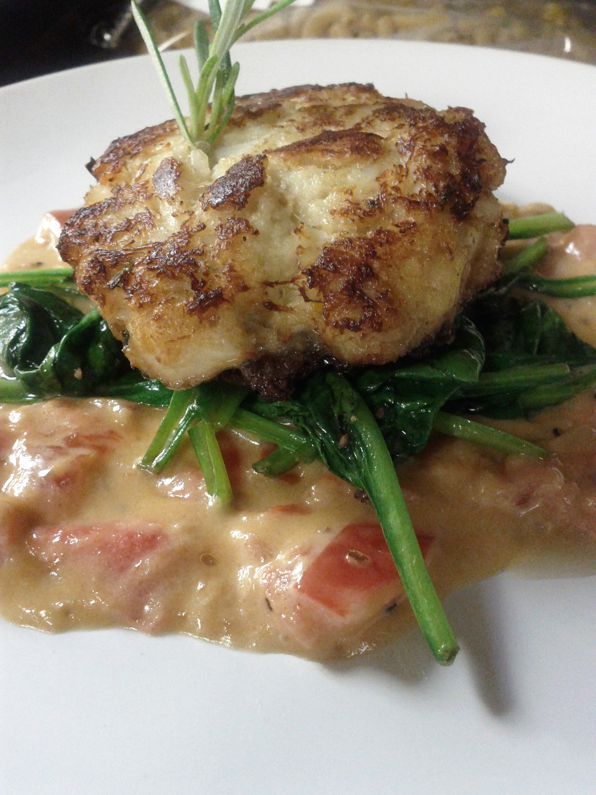 Pan seared crab cake with garlic wilted spinach and tomato / white wine pan sauce