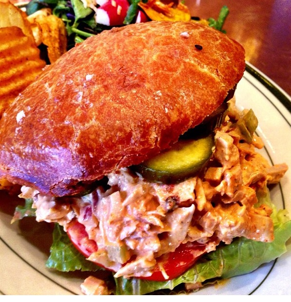 Chicken sandwich with chili mayo, pickles and old bay potato chips from @roosterharlem