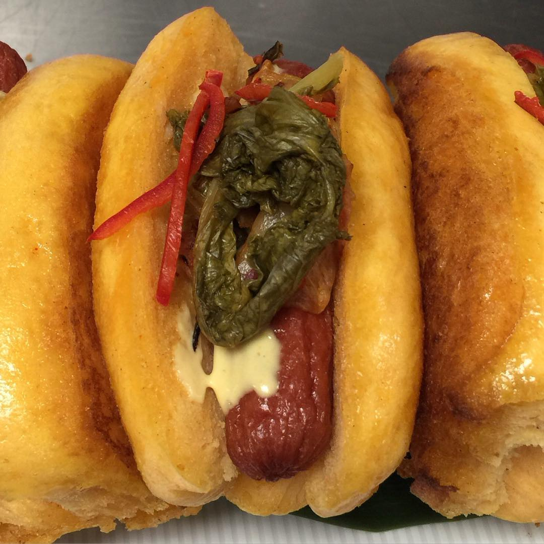 @ChefMarcMarrone made us these Wagyu beef hotdogs with pickled mustard green, Kimchi relish in a house made sweet potato Bao bun!! Without a doubt Approved!!😍🔑💣