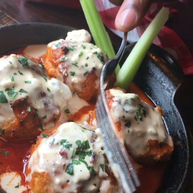 These Buffalo chicken meat balls from @forkandballs are incredible! Tender & juicy chicken meat balls topped with buffalo sauce and blue cheese that send your mouth into a frenzy! Chicken wings may have a competitor