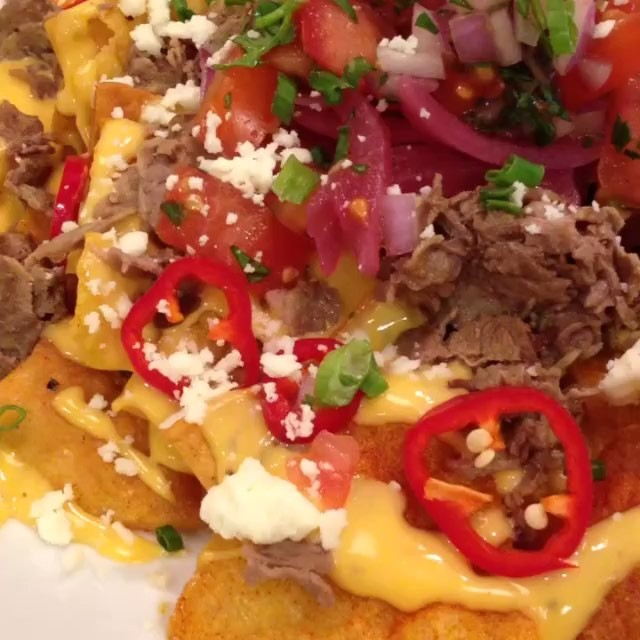 The Cheese Steak Nachos with Pickled Red Onions, Fresno Chilies, Pico, Cheddar and Queso Fresco from @BlueDuckPhilly is and @FoodChasers Approved!! 💣🔥👌🏽
