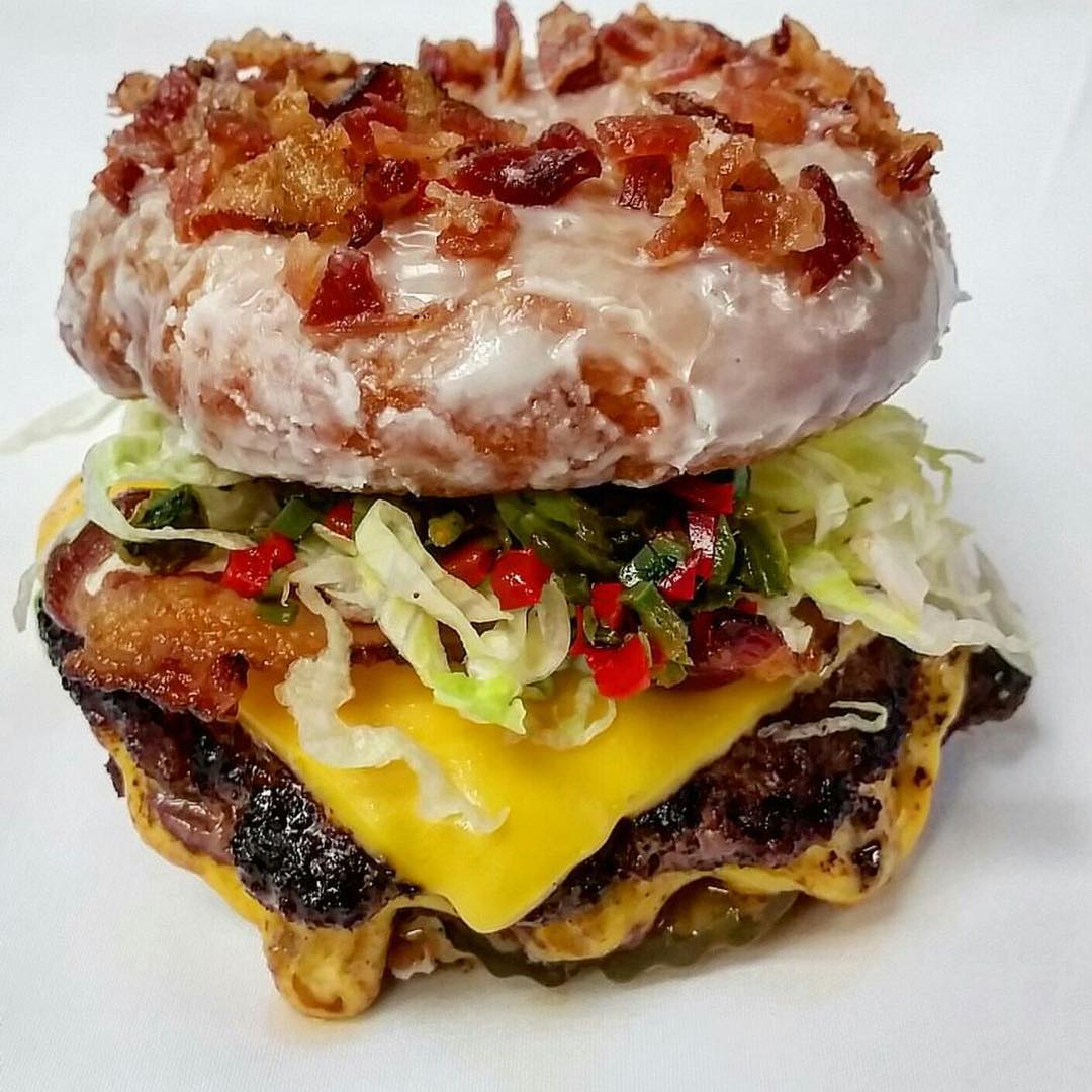 Rootbeer Bacon Glazed Donut Burger 😳😍🍩🍔 with Cheese, Pickled Chilis, Lettuce, Pickles and Chili Mayo!! Hey @ChefMarcMarrone you had us at Bacon, It's ok to Drool Y'all!!