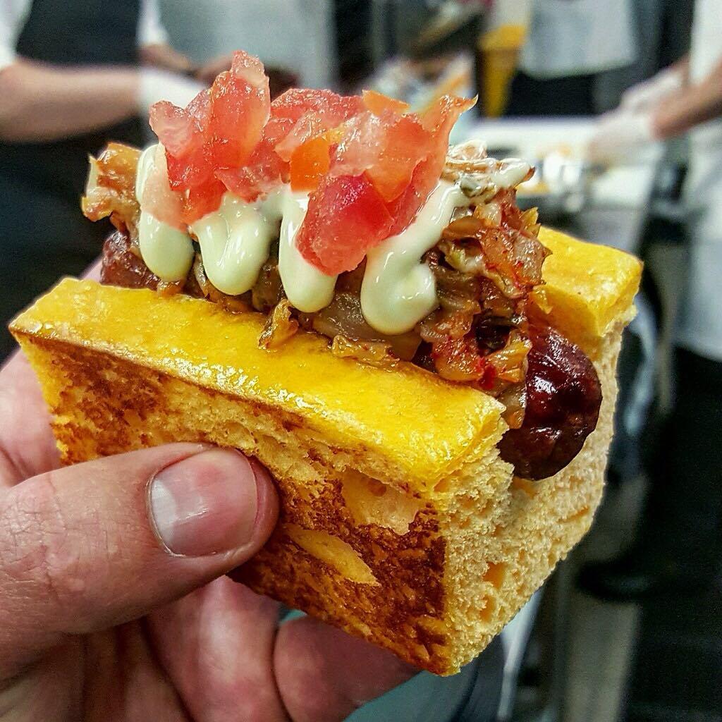 Wagyu hotdog on a sweet potato bun with wasabi aioli, kimchi and tomato perfected by @chefmarcmarrone for @taobeach! 😳😍😳